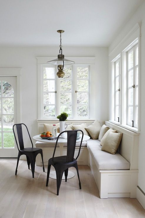 Breakfast nook with lightness and  openness to the outdoors.  The contemporary black chairs are the finishing touch to liven it up.