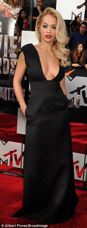 "Best dressed @ 2014 MTV Movie Awards | Rita Ora in a black Barbara Casasola gown with a plunging neckline paired with an Edie Parker ""Hold it"" box clutch"