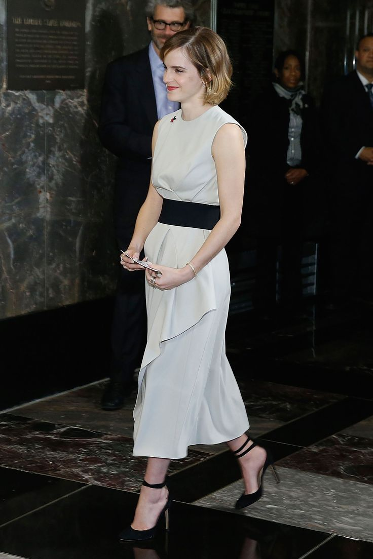 Emma Watson was at the Empire State Building celebrating International Women's Day in a chic cream Narciso Rodriguez dress with black strappy heels - 8 March 2016