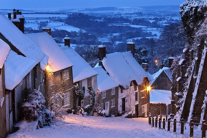 Beautifully quaint Gold Hill, glowing in the midst of winter . Shaftesbury  Devon, England
