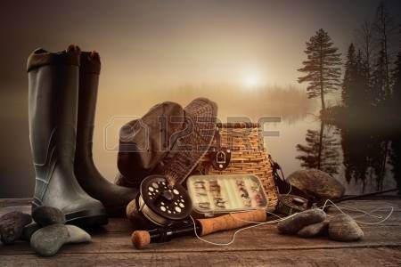 Fly fishing equipment on deck with view of a misty lake background. Stock Photo - 14832146