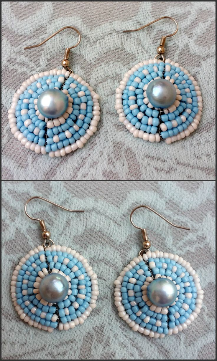 This is a pair of earrings, handmade by myself, Annalee Beer of EverAfter Artisanry. They have cute pastel blue and white glass seed beads, and each earring contains a pale blue freshwater pearl in the center.