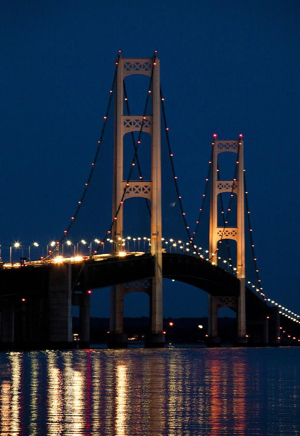 The Mackinaw Bridge at Night by the Straits of Mackinac between Lake Michigan and Lake Huron; photo by Randall Nyhof