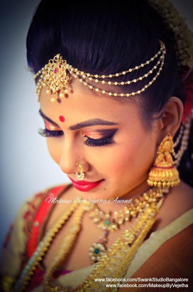 Our gorgeous bride Charita for her muhurtam. Makeup and hairstyle by Vejethe for Swank Studio. Photo credit: Manish Ananda. Nose ring. Maang tikka. Red lips. Glitter smokey eye makeup. Bridal jewelry. Bridal hair. Silk sari. Jhumkis. Indian Bridal Makeup. Indian Bride. Gold Jewellery. Tamil bride. Telugu bride. Kannada bride. Hindu bride. Malayalee bride. Find us at https://www.facebook.com/SwankStudioBangalore