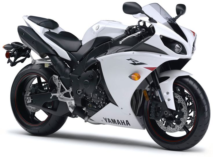 The Yamaha YZF-R1, a true 998 cc 16 valves, 4-inline engine superbike you can just go to a store and buy. Bringing engine technology from the MotoGP M1 and a spectacularly linear power delivery thanks to its crossplane crankshaft. Its extreme power (146 HP) and top speed (299 Kph) are almost offwordly.