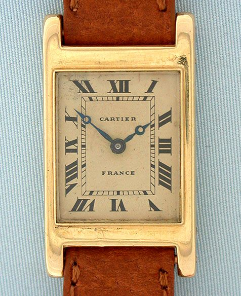 Cartier - Backwind Manual Tank Wrist Watch. 18 Karat Yellow Gold with Leather Strap. France. Circa 1932.
