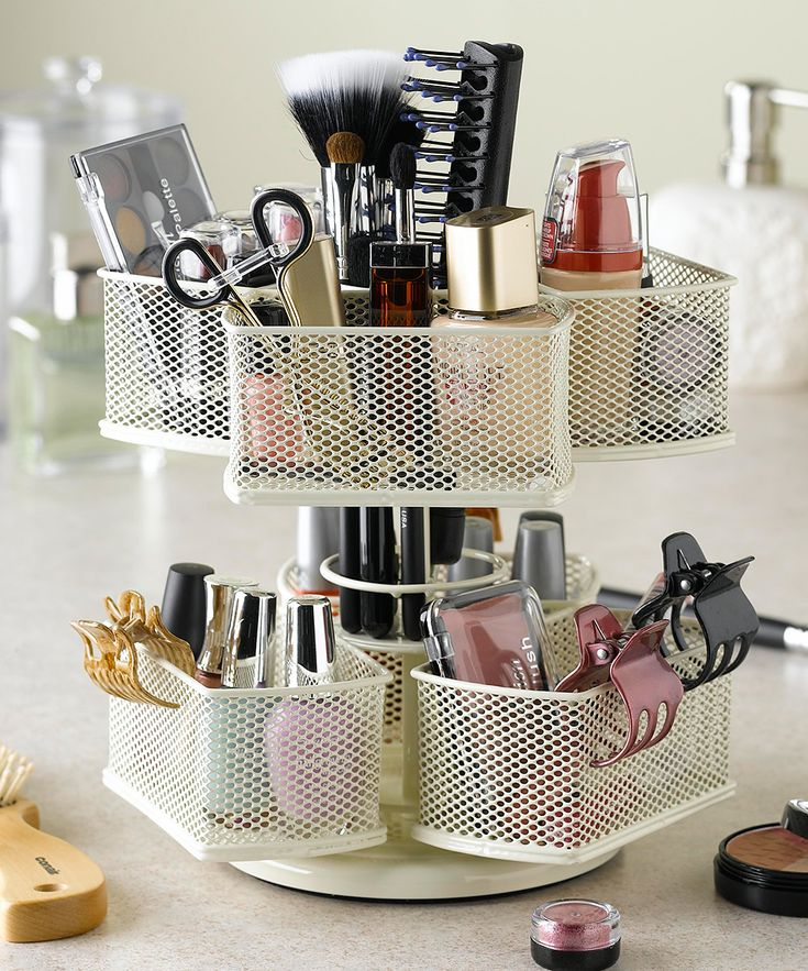 Nifty Home Products Cream Makeup Carousel   Banish clutter and disorganization with this powder-coated makeup carousel that organizes, stores and displays a variety of brushes, bottles, accessories and more. The spinning base ensures easy access to every item.
