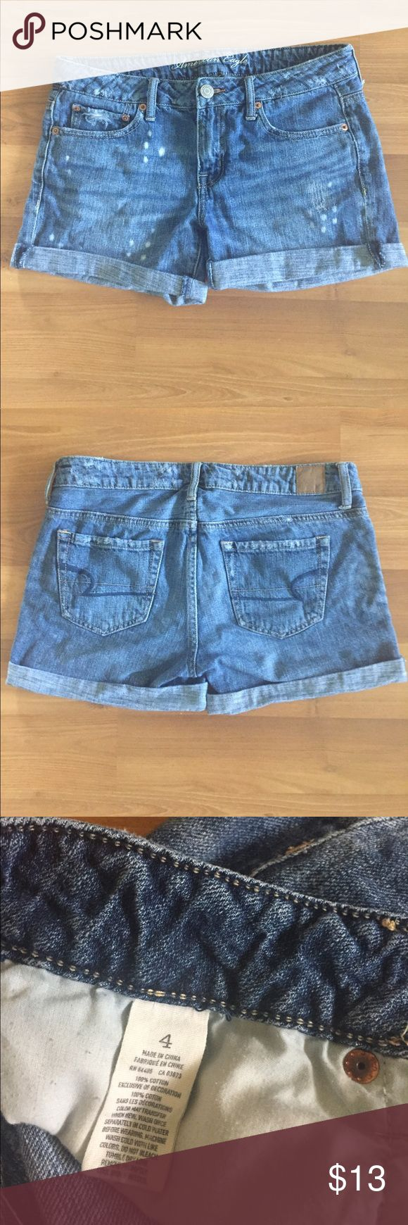 """American Eagle Shorts American Eagle Distressed Cuffed Denim shorts medium wash Size 4 with about a 3"""" inseam and 12"""" length. These don't fit me so I can't model them. Measurements in photos American Eagle Outfitters Shorts Jean Shorts"""