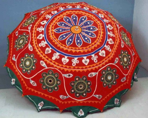 Red Applique work umbrella with beautiful thread work and mirrors