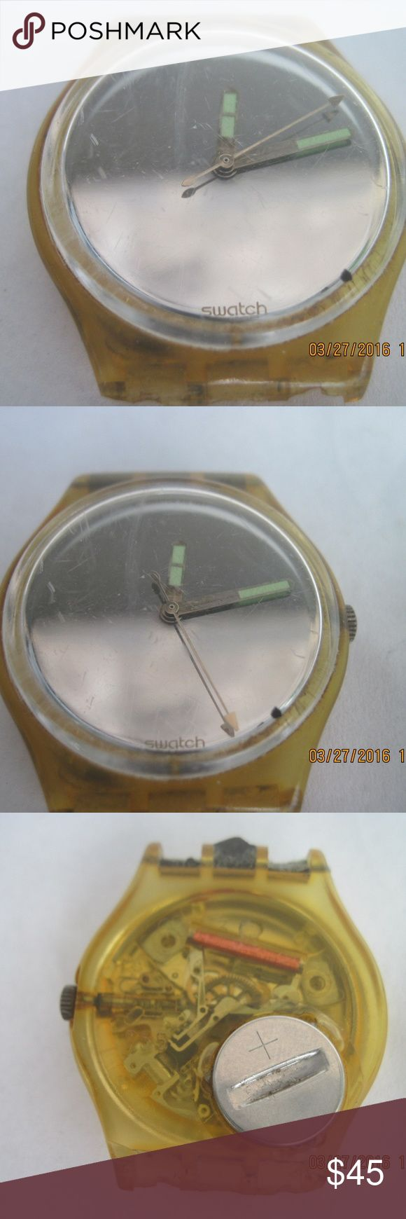 """Men's SWATCH Swiss Made Watch w/o Band & Numbers WORKING WATCH without band in a workin and used condition.  Features: Missing band that appears to have been broken off from the base. Some scratches on the crystal. Swiss made. Battery included. Glow in the dark hand tips.Plain face without numbers, etc.. Vintage 1987.   Measurements include: 1.25"""" wide. Swatch Accessories Watches"""