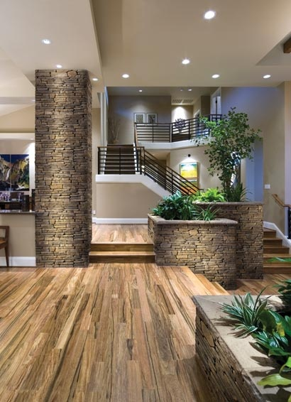 Welcome to my dream...wood floor, stone column and planters - all it would need are more windows...