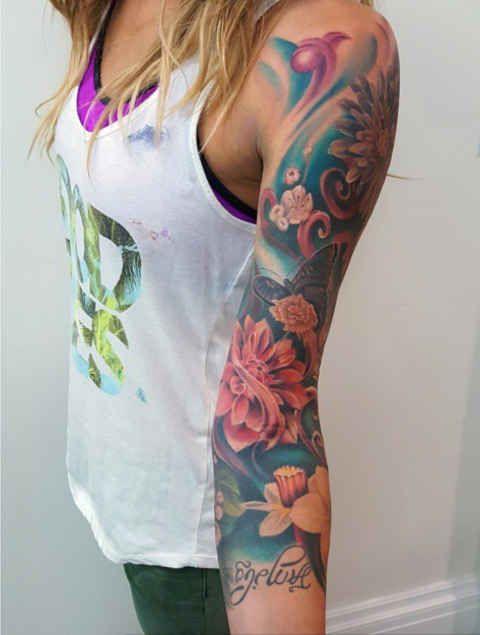Colourful arm tattoos by Mor Mogli Cohen.