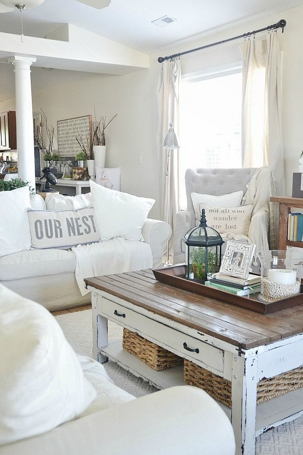 Lovely neutral living room - Cozy ikea slipcovered couches, rustic touches, & antiques. Beachy living room.