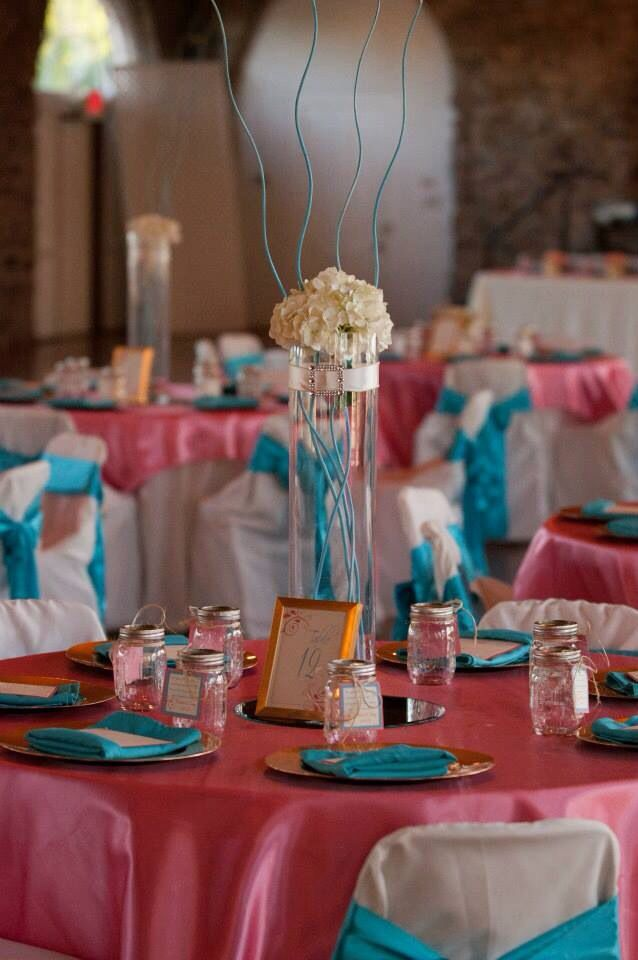 Camellia Events|Samuel's Wedding|Guava & Aqua wedding decor accented with gold and ivory. We used fresh hydrangeas and painted the bamboo sticks aqua blue to match the color scheme.