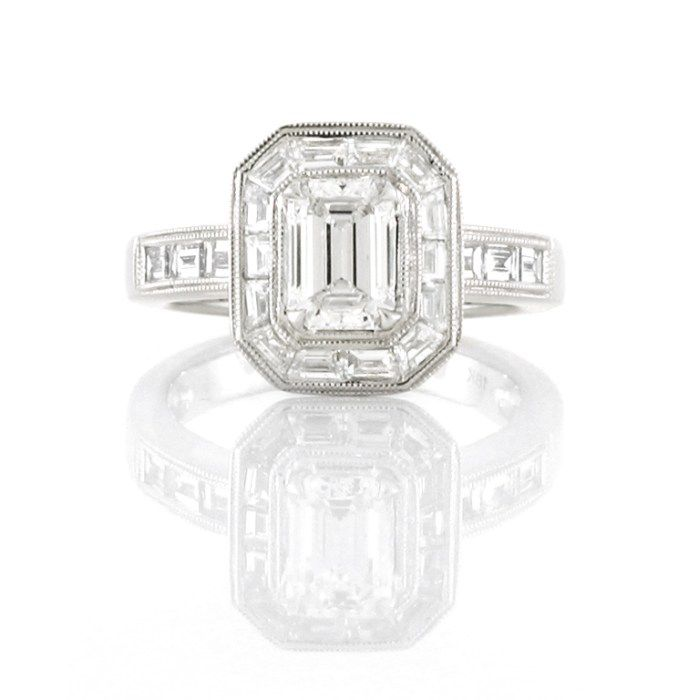 An Art Deco Inspired 18ct White Gold and Diamond Halo Ring