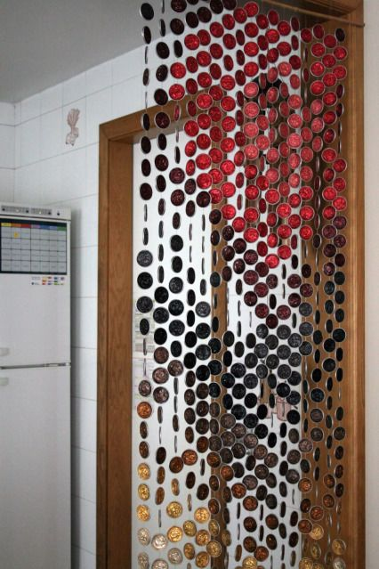 "Curtain made of Nespresso coffee capsules... Great idea & since my machine should arrive tomorrow I need to assuage my ""garbage-guilt"" by planning a use for the used capsules."