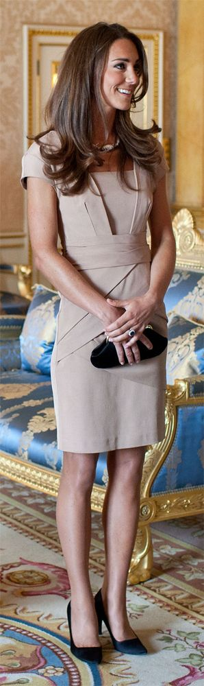 "The Duchess of Cambridge  met talking with Michelle Obama at Buckingham Palace May 24, 2011. She was wearing a Reiss ""Shola"" nude bandage dress."