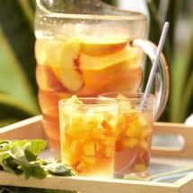 How to Make a Summer-Fresh Peachy White Wine Sangria :: this was delish.  threw in some brandy, apples and pears.
