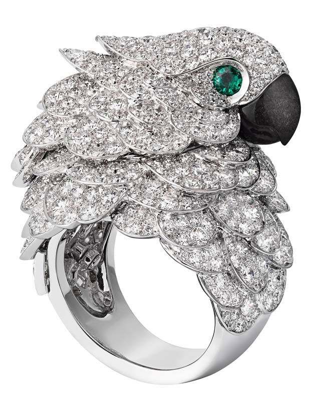 @Cartier Fabuleux parrot watch and ring; watch and ring in rhodium-plated white gold set with brilliant-cut diamonds, beak in mother of pearl, eyes set with emeralds.