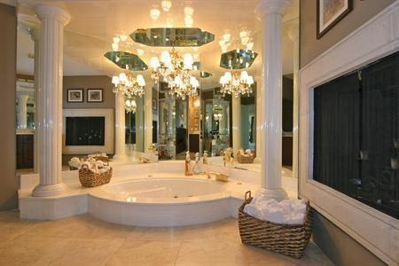 Incredible Bathtub and chandelier!