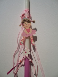 Greek Easter candle (lambada) for kids decorated with a wooden ballerina, flowers and beads.