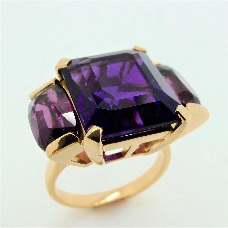 Amethyst and almondine garnet dress ring set in 18 carat rose gold