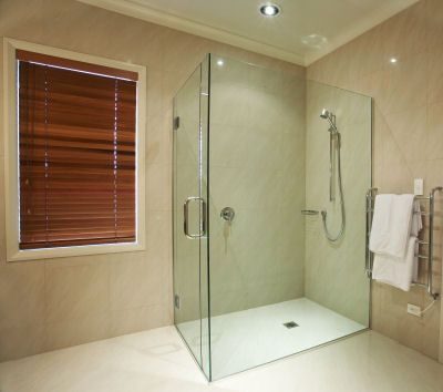Glass surround for shower