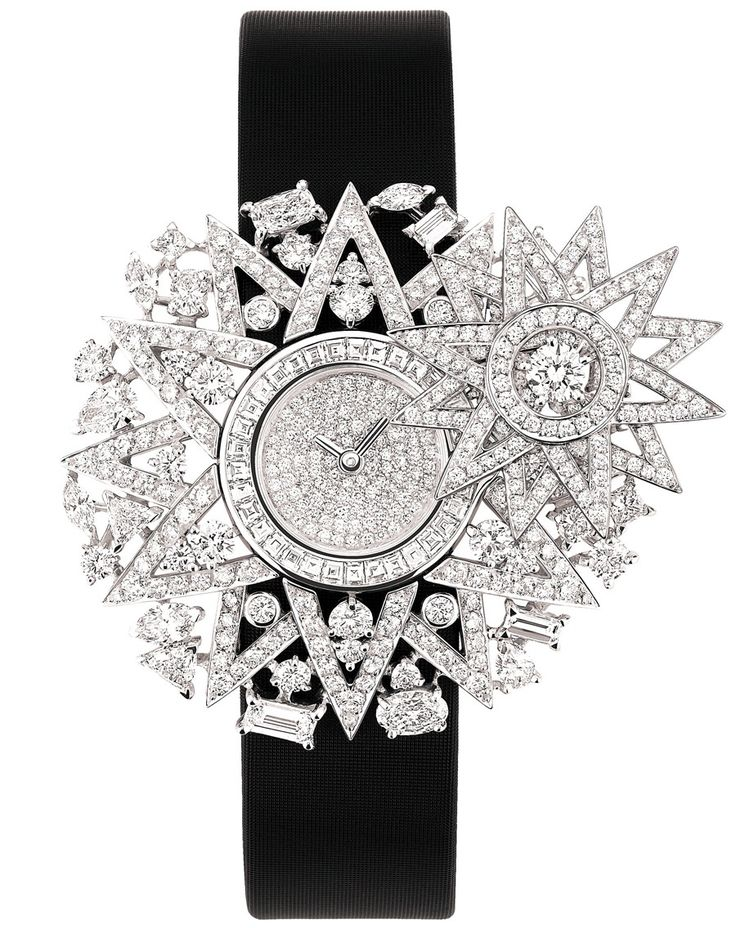 """Chanel """"Cosmos"""" watch in 18-karat white gold set with 537 brilliant-cut diamonds for a total weight of 4.2 carats, 29 fancy-cut diamonds for a total weight of 3.8 carats and 31 princess-cut diamonds for a total weight of 0.9 carat. Black satin bracelet. Quartz movement."""