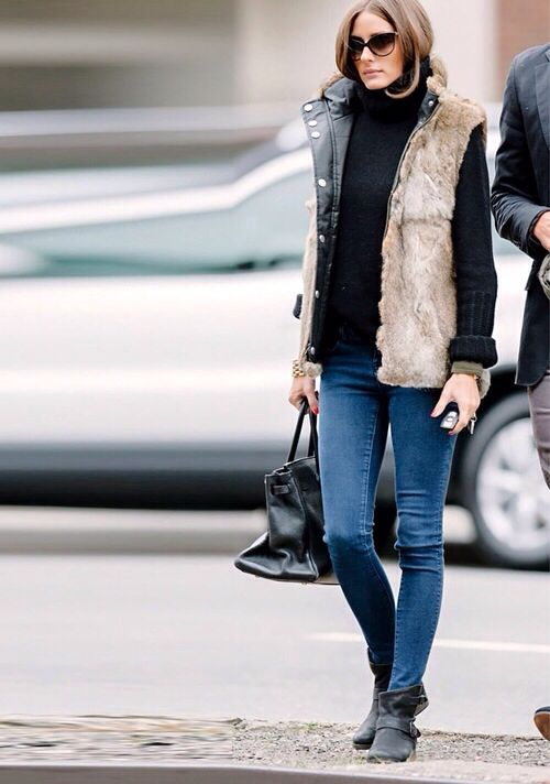 Jeans, black turtleneck and moto boots by Olivia Palermo