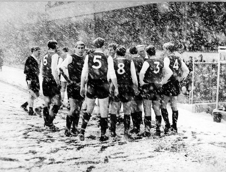Sheffield Wednesday players gather on the side line at Highbury during their match against Arsenal. The match was abandoned after 47 minutes due to the heavy snow fall. December 1967