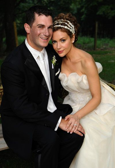 Actress Alyssa Milano and her fiance David Bugliari tied the knot in New Jersey Saturday August 15, 2009. The bride wore a custom Vera Wang crumb-catcher gown and carried lilies of the valley.