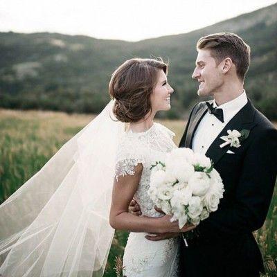 A beautiful wedding photo featuring an Alta Moda bridal gown - love the hair too!