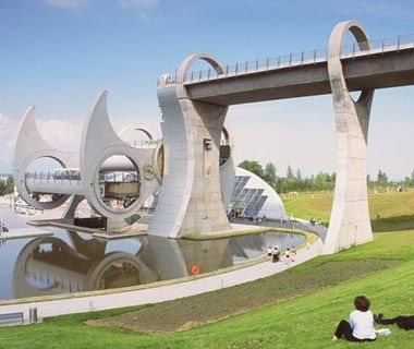 Falkirk Wheel, Falkirk, Scotland ~A series of 11 locks once raised small ships the 115 feet from the Union Canal to the Forth and Clyde Canal above. When the entire mechanism was disassembled in 1933, this vital shipping link was broken. Seeking to reconnect the two canals, in 2002, British Waterways built the Falkirk Wheel, a strange contraption that allows ships to sail into a sealed bathlike pod that then rotates, bringing the boat to the new water level above. Courtesy of The Falkirk…
