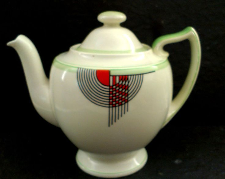 Doulton deco: Tango tea pot, V1484, c1934 (7). Green colourway - abstract geometric design with black, orange and green highlights on ivory ground and green trim. Rare colourway.