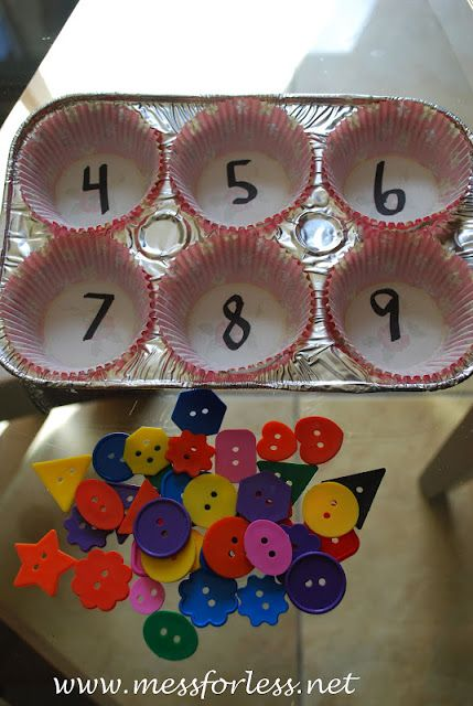 Counting Game with Buttons and Muffin Cups. I've also seen this done with egg cartons. Can also use candy corn, candy hearts, and other small objects.: