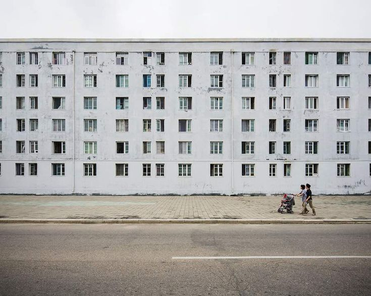 Passers by in Pyongyang city centre - Photo by Raphael Olivier.