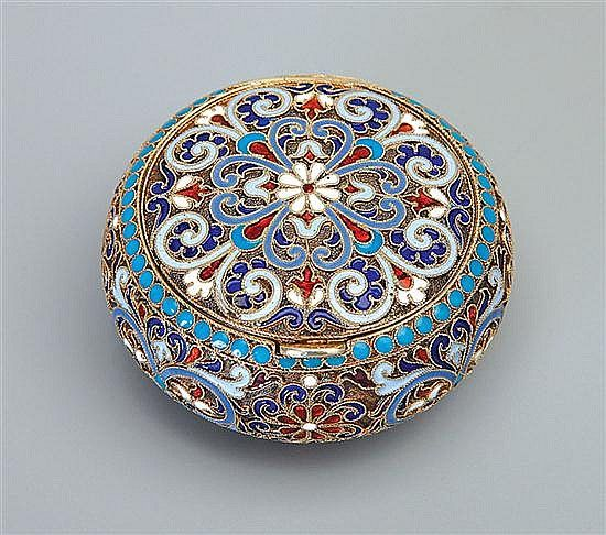 A Russian silver-gilt and cloisonne enamel bonbonniere, Gustav Klingert, Moscow, circa 1890 the body enamelled with flower heads and leaf scrolls on stipled ground with turquoise dot borders, 84 standard 6 cm diameter