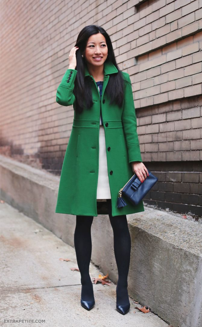 Green lady day coat and navy bows