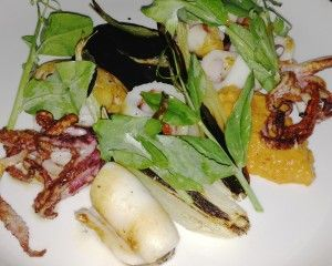 At Estela, NYC - grilled calamari with orange sections, charred onions and a romesco (nut and red pepper) sauce ($14)