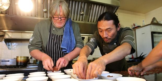 """Chefs Kent Baddeley and Masanori Takahashi, prepare some """"hellishly good food"""" for the Winter F.A.W.C! event Heaven and Hell. Photo / Duncan Brown"""
