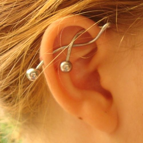 industrial. Ok. I have intustrial and I bought this kinda jewelery. How does she got it in hes ear?