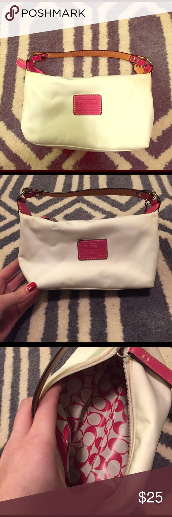Authentic Coach purse, canvas material Authentic Coach purse. Canvas material. Outside has some staining (see pics)  - may be able to be cleaned. Super cute and fun white and pink color with brown detail on side. Coach Bags