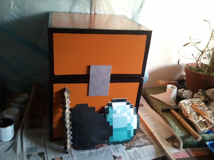 A suprise Minecraft chest replica made for a friend. Didn't have time to make the other objects out of foam. Inside the stick, coal and diamond are small presents.