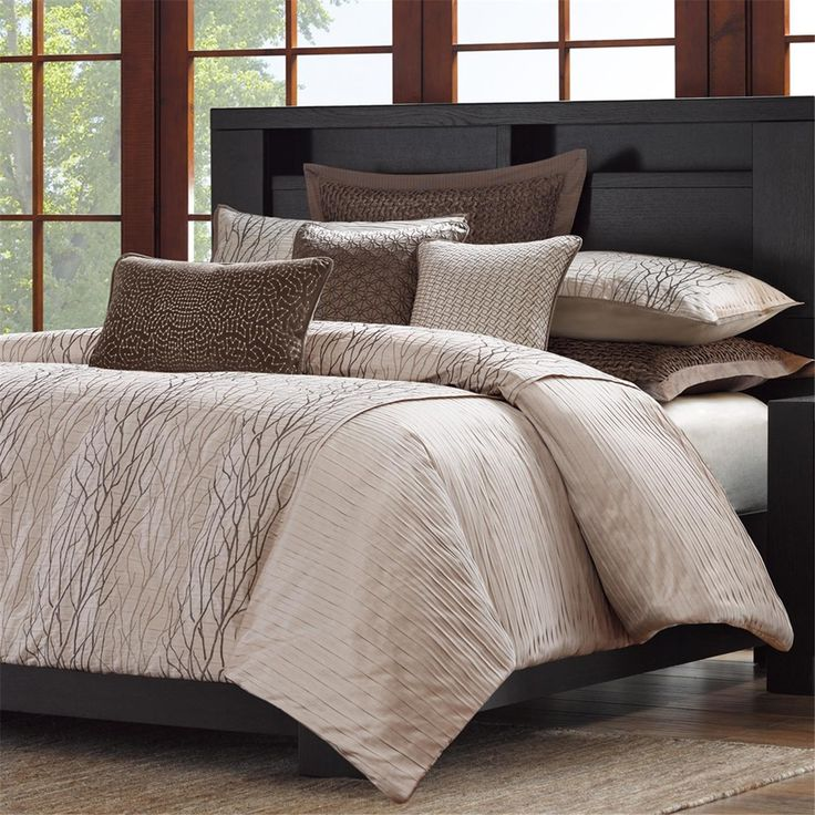 The Eclipse bed will add a modern touch of style to your room. Intricate metallic embroidery draws the eyes to the center while the pleated sides and textured fabric adds dimension on a soft taupe ground. Duvet style comforter with removable insert offers easy care. Includes 2 standard shams, 1 comforter, and 1 removable insert.