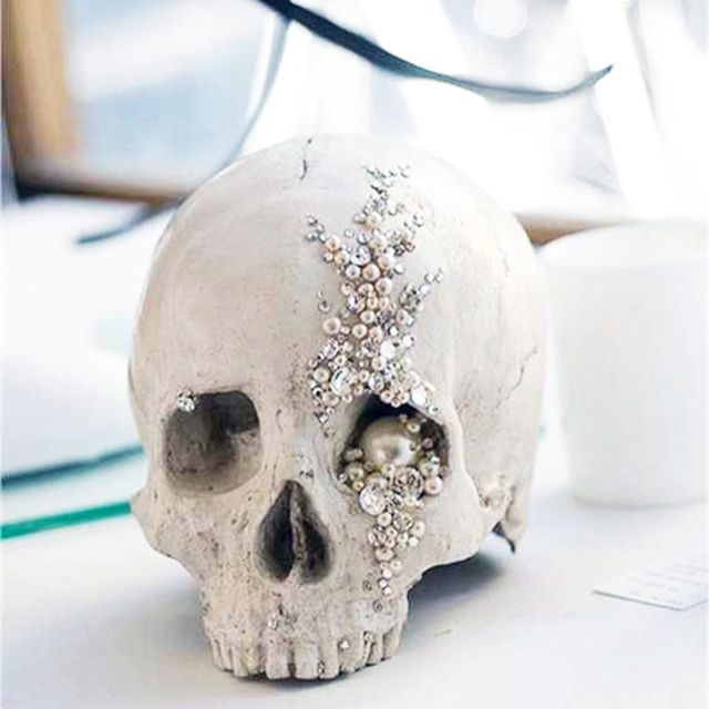 Skull with some pearl embellishment. Could be nice for a shabby chic interior, but not quite sparkly enough for my taste.