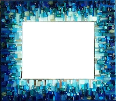 Really want to make my own mosaic frame someday with blues and lime green... =)