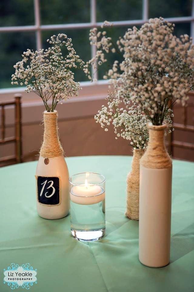 Shabby Chic baby's breath and wine bottle wedding centerpieces by James Hurley Designs (Liz Yeakle Photography)