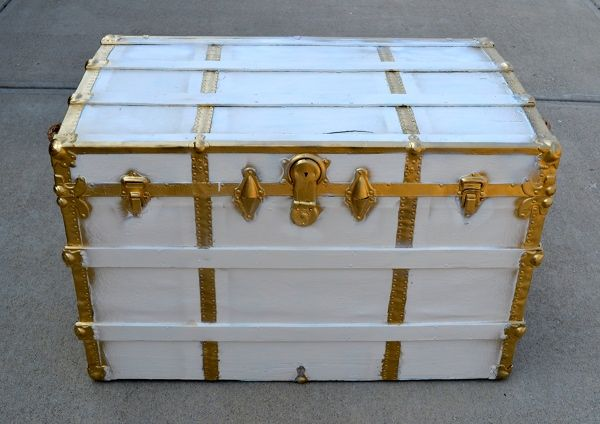 white and gold painted trunk