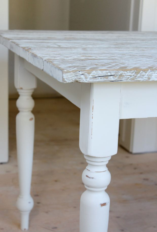 Want a salvaged wood farmhouse table? They're easier to build than you'd think. Check out how we transformed our existing wood table using reclaimed wood and a white-wash technique.