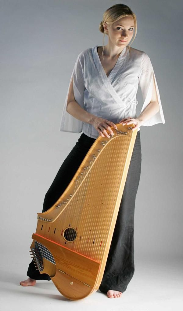 Eva Alkula, kantele player | A kantele or kannel is a traditional plucked string instrument of the zither family native to Finland, Estonia, and Karelia. It is related to the Russian gusli the Latvian kokle and the Lithuanian kankles. Together these instruments make up the family known as Baltic psalteries. The oldest forms of kantele have 5 or 6 horsehair strings and a wooden body carved from one piece. From melodiasoitin.co.uk